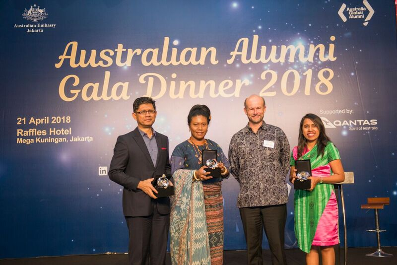 Four people wearing formal outfit at Gala Dinner
