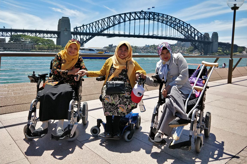 Three aspiring Indonesian scholars experience accessibility in public facilities first-hand at the Sydney Harbour Bridge during an Organisational Leadership and Management Practices for Disabled People's Organisations short course. The course is facilitat